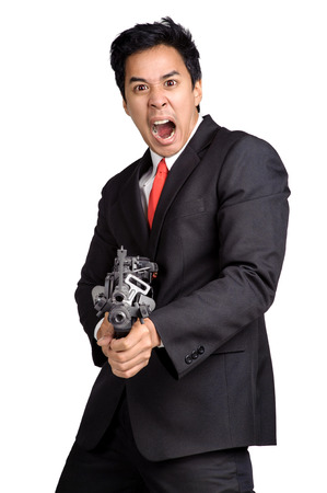 business man hold Machine gun shoot in isolated photo