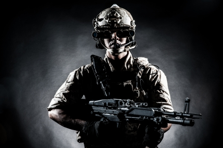 soldier man hold Machine gun fashion