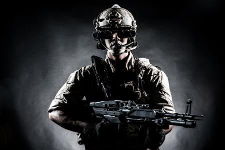 gun control: soldier man hold Machine gun fashion