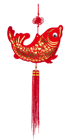 arowana: Fish wind chime the symbol of wealth fengshui Stock Photo