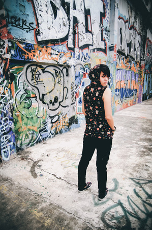 emo: young beautiful punk emo Coat with Hood a background graffiti