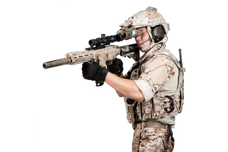 working hands: soldier man full armor hold machine gun isolated Stock Photo