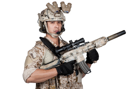 controlling: soldier man full armor hold machine gun isolated Stock Photo