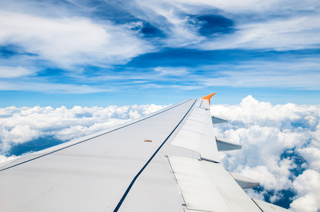 looking through window: Looking through window aircraft during flight in wing blue sky