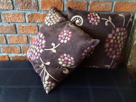 pillows: Brown pillows on the black sofa