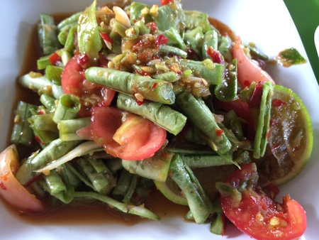 long bean: Long bean salad mix with spices, tomatoes, fish sauce, and limes