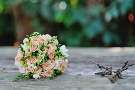 bridal bouquet of roses on a wood table