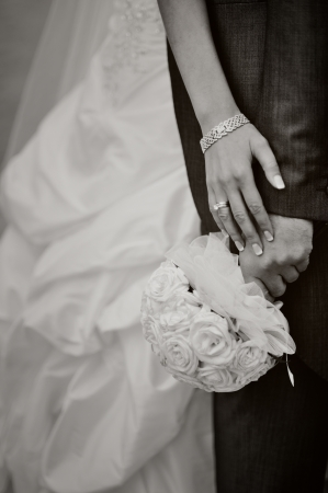 bride and groom embraces, hands, black and white Stock Photo