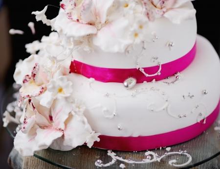 wedding reception decoration: wedding cake decorated with creamy flowers  Stock Photo