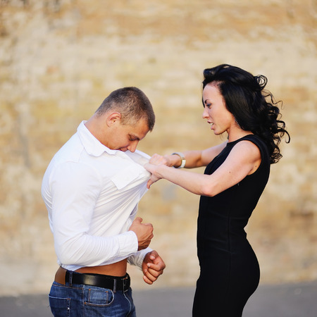 aggression: young woman attacks her boyfriend, aggression Stock Photo