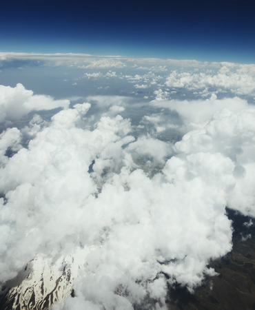 looking through window: Ten kilometers high over clouds. Flying over Syria. Looking through window aircraft. Stock Photo