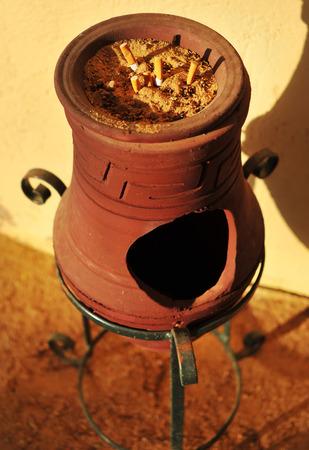 trashcan: old clay trashcan