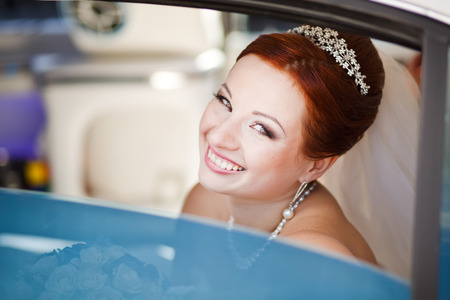 Lovely red hair bride in white limo.