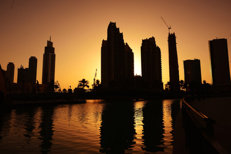 skylines: Skylines against sunset, city growing up