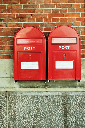 red post box: Red post box with postcards Stock Photo