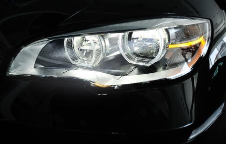 headlight: Headlight of a brand new car.