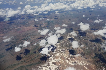 looking through window: Flying over Syria. Ten kilometers  high over clouds.  Looking through window aircraft.