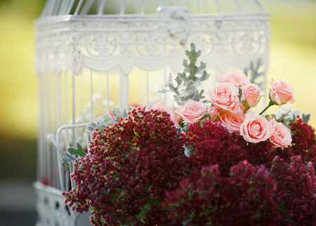 Beautiful Wedding decoration. White cage and pink roses.