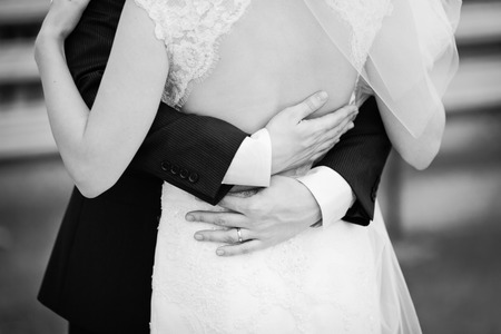 hold me, trust me, marry me today, newly wed couple in black and white Stock Photo