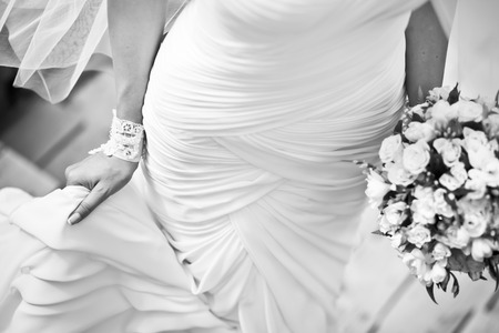 Young bride in wedding dress, black and white