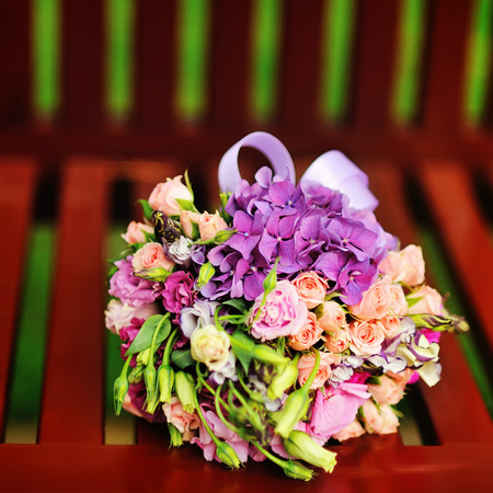 bridal bouquet: Magnificent Bridal Bouquet of various flowers on a bench