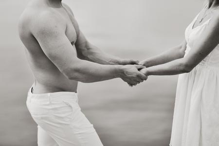 heterosexual: Symbol of  togetherness. Hands of heterosexual couple.