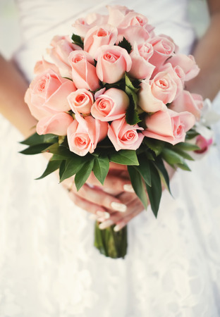 wedding bouquet: bride holding beautiful wedding  bouquet. Stock Photo
