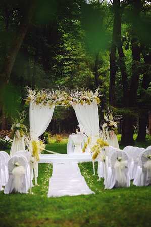 wedding ceremony in oak garden Stock Photo
