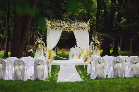 wedding ceremony in oak garden Stock Photo