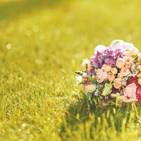 descriptive colours: Wedding bouquet in sunlight. Summer wedding.