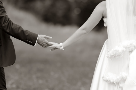 Hands of wedding couple. Picture in black and white. Togetherness.
