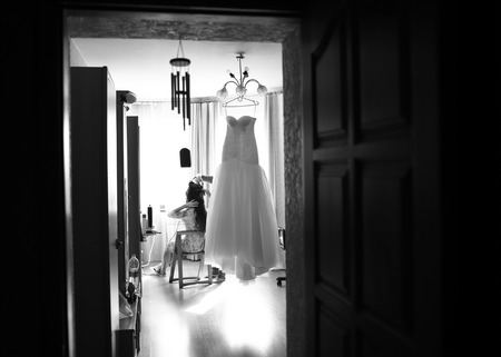 marriageable: Bride is getting ready in the morning at home.