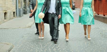 bridesmaids: Husband and bridesmaids having fun