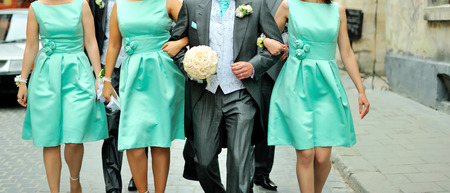 bridesmaids: Husband takes bridesmaids for support Stock Photo