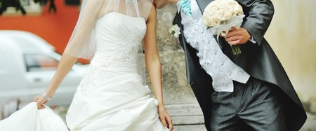 newlywed couple: Newlywed couple holding hands. Spending happy wedding day together. Stock Photo