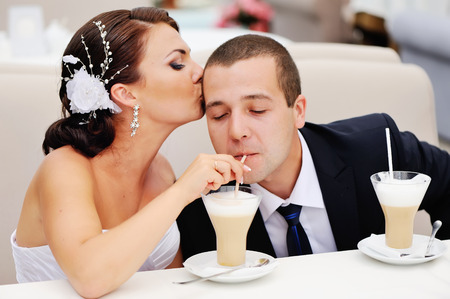 wed: Love you honey.  Newly wed couple drinking cappuccino in cafe.