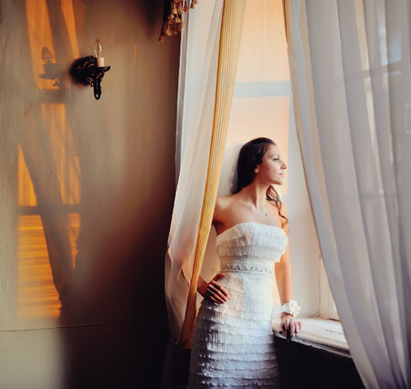 looking into: young beautiful bride  looking into the window Stock Photo