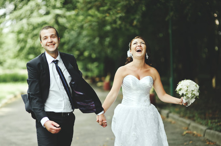 happy wedding: Newly wed couple going crazy. Groom and bride together.