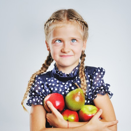 going crazy: Little pretty girl going crazy with apples