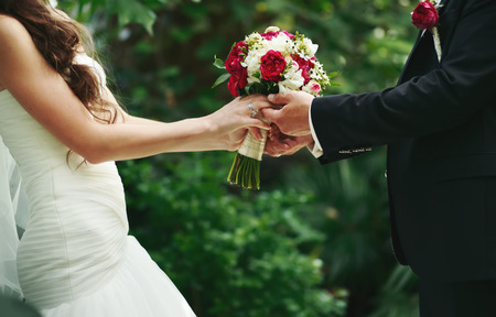 wedding flower: marry me today and everyday, hands of a wedding caucasian couple Stock Photo