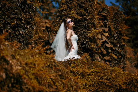 fiancee: Young happy  fiancee in park.  Indian summer color style.