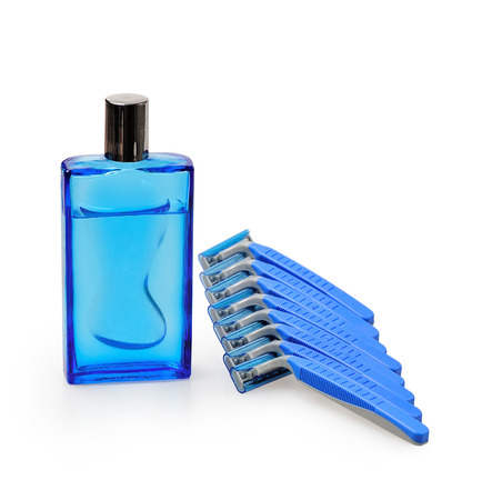 medium body: blue disposable razors with after shave, isolated on a white background