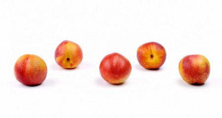 five objects: five peaches on a white background
