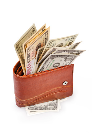 us paper currency: brown wallet with US Paper Currency on the white background