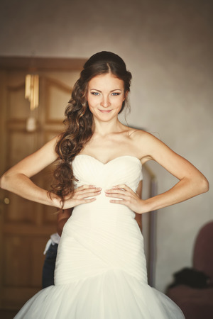 marriageable: Beautiful bride at home getting ready.