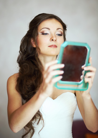 marriageable: Bride enjoying herself looking into mirror. Bridal morning.