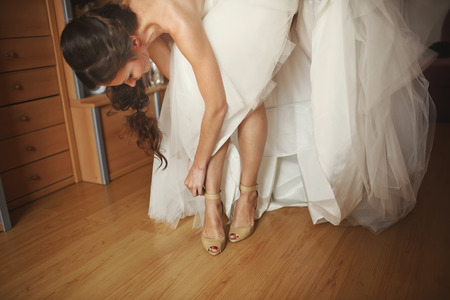 marriageable: Young  bride  is getting ready in the morning at home.