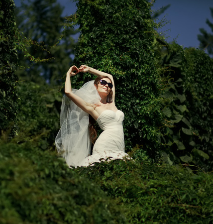 marriageable: Young bride in garden, sunny summer day.