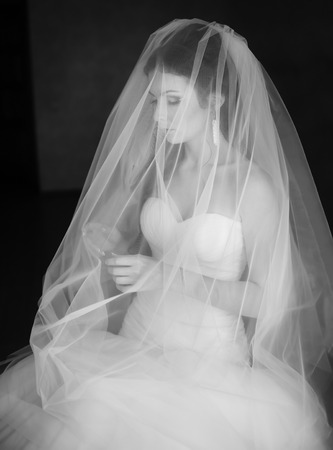 marriageable: Young caucasian bride at home waiting for groom. Black and white picture. Stock Photo