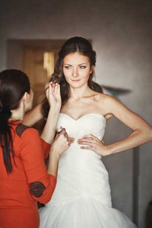 marriageable: young caucasian bride having morning make up, getting ready Stock Photo